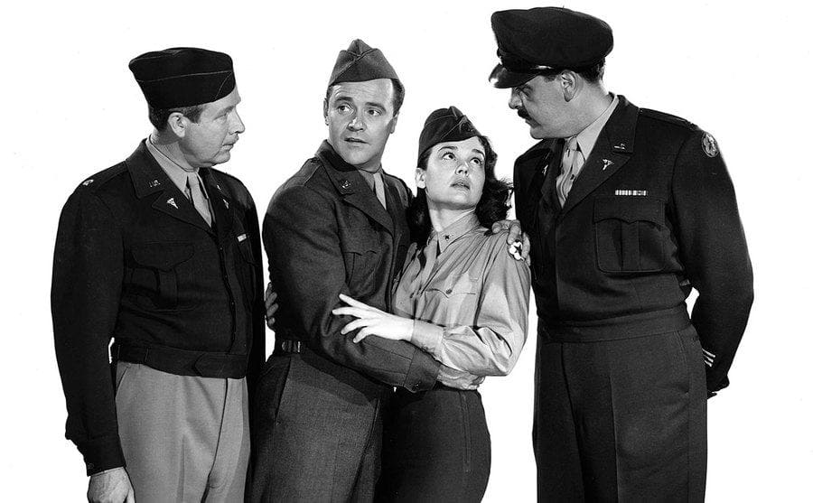 Arthur O'Connell, Jack Lemmon, Kathryn Grant, and Ernie Kovacs standing in a military uniform