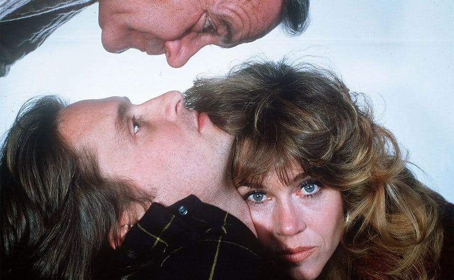 Jane Fonda leaning on Michael Douglas and Jack Lemmon above looking at them