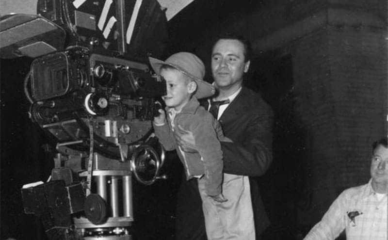 Jack Lemmon holding his son behind a cinema camera