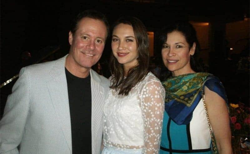 Chris Lemmon, Sydney Noel Lemmon, and Gina Raymond standing together.