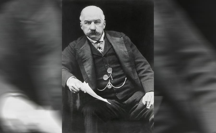 J.P. Morgan photographed sitting in a chair