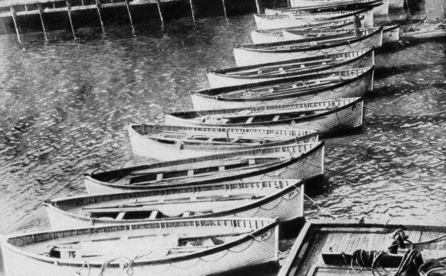 Lifeboats lined up at a dock from the Titanic survivors