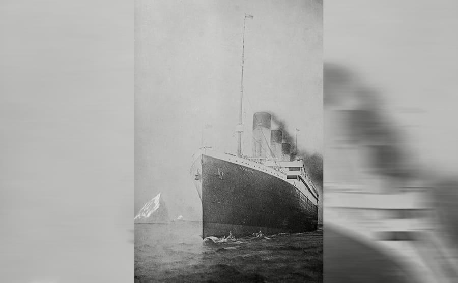 The Titanic passing an iceberg