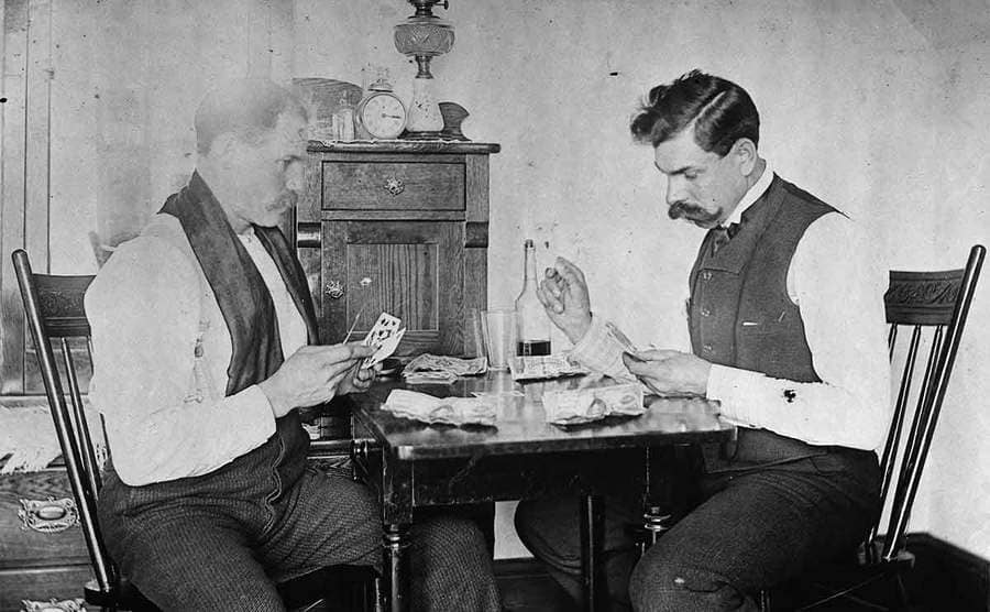 Two men playing a card game
