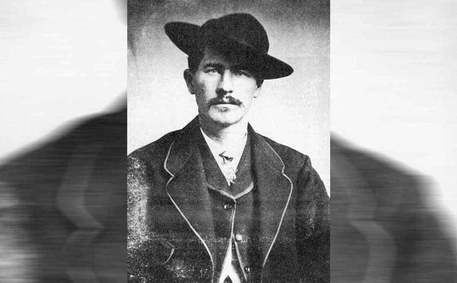 A portrait photograph of Wyatt Earp wearing a cowboy hat