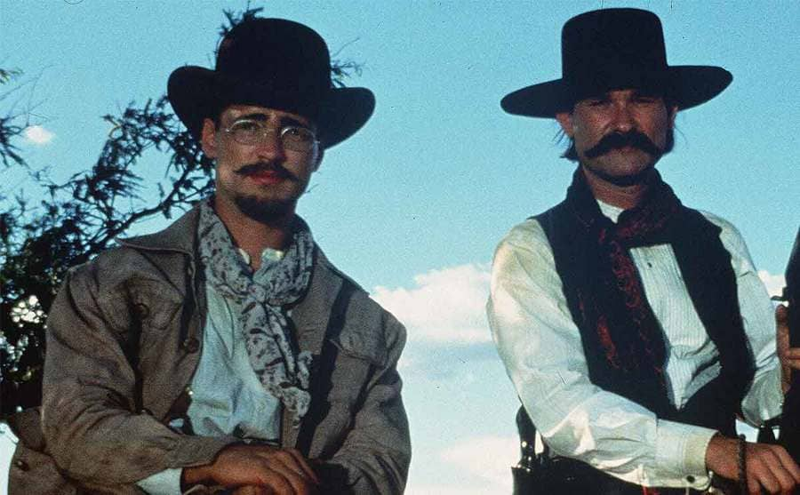 Jason Priestley, Kurt Russell, and Val Kilmer on horses in a scene from Tombstone