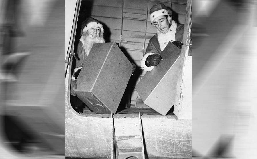 William Jr and William Sr working inside of the plane while loading it with packages