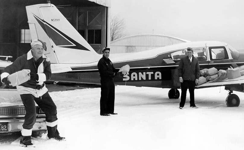 Edward Rowe Snow working with the other to pack up a plane