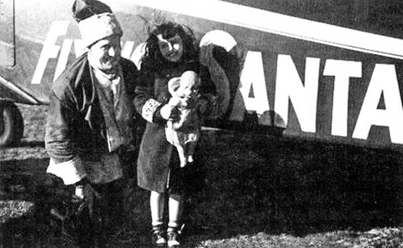 Seamond Ponsart with Edward Rowe Snow posing outside of his plane circa the early 1940s