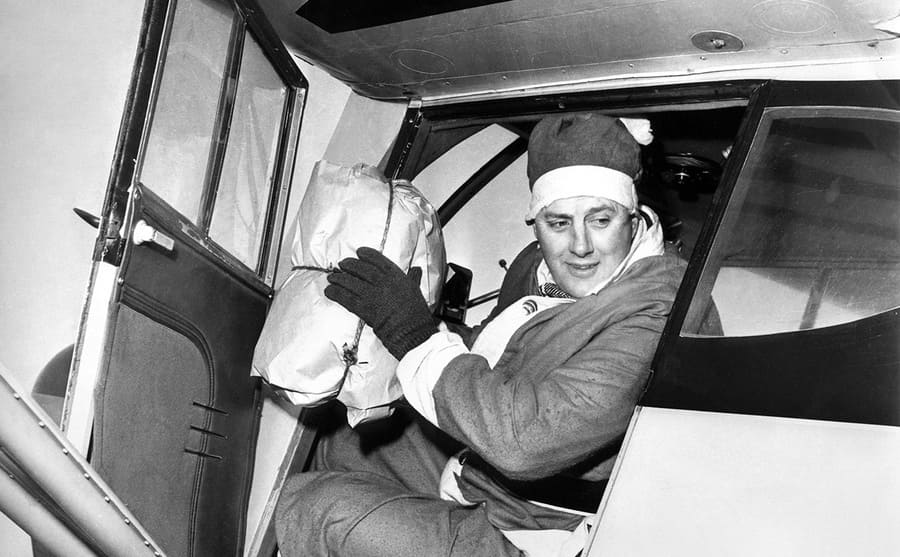 Edward Rowe Snow dropping a package