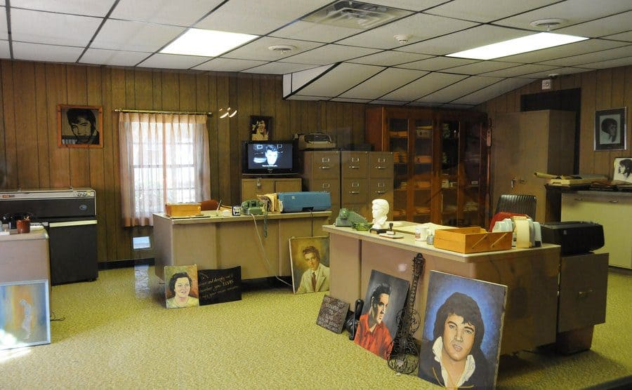 The bat cave for the boys looks like an office with filing cabinets and two beige metal desks I the middle