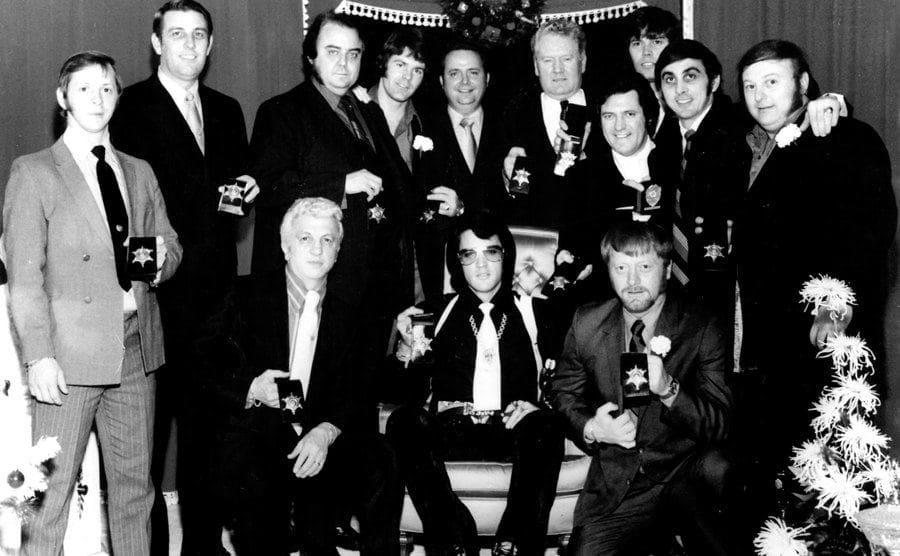 Elvis Presley posing with the Memphis Mafia