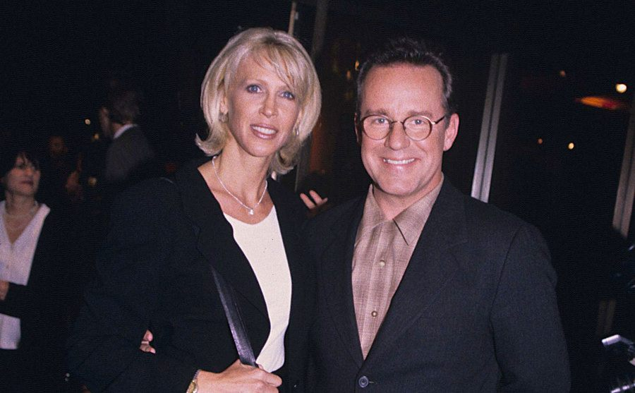 Brynn and Phil Hartman posing together at an event