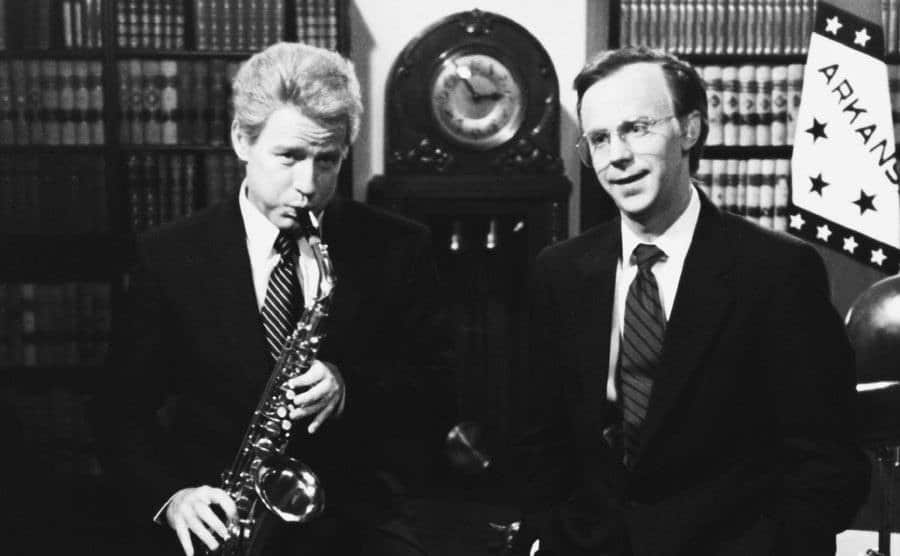 Phil Hartman and Dana Carvey, who is playing saxophone, in a scene from SNL