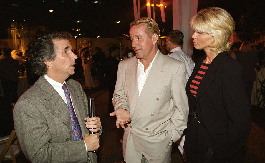 Henry Winkler talking to Phil and Brynn Hartman on the red carpet in 1995