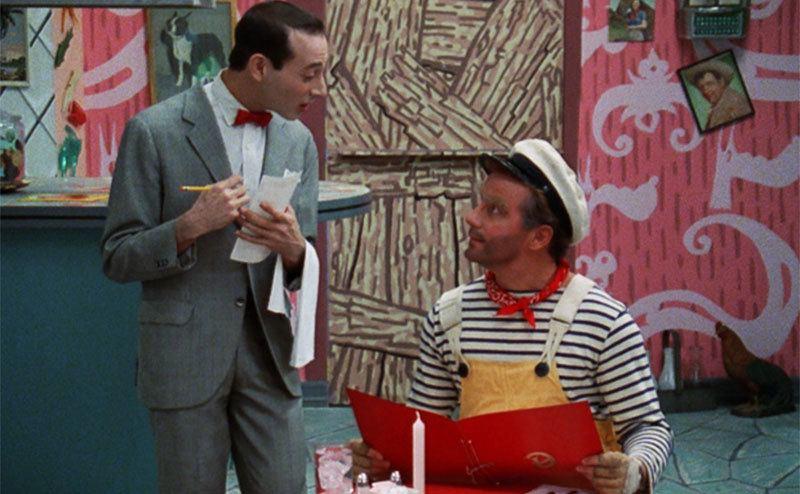 Pee Wee Herman taking Phil Hartman's order in a scene from Pee Wee's playhouse