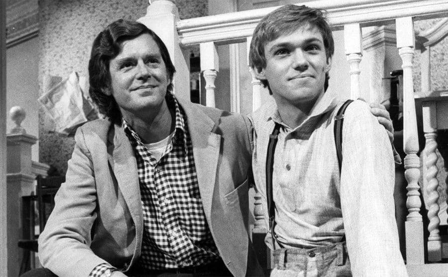 Earl Hamner Jr and Richard Thomas sitting on a porch