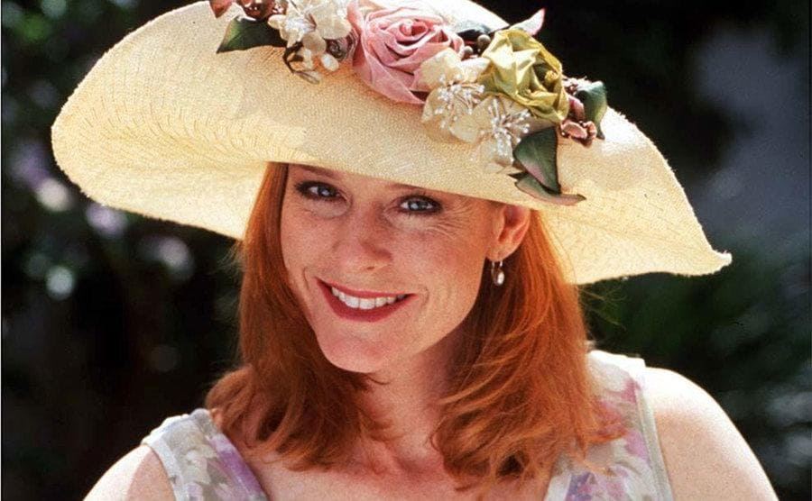Mary McDonough smiling wearing a big white hat