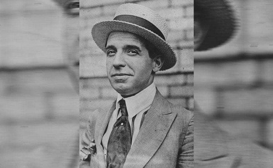 A portrait of Ponzi wearing a wicker hat