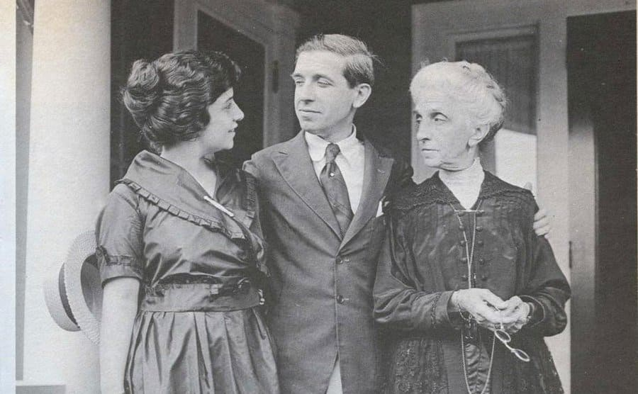 Charles Ponzi on front steps with his wife and mother posing for a photograph