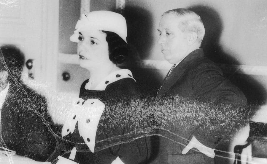 Charles Ponzi and his wife standing in an office room