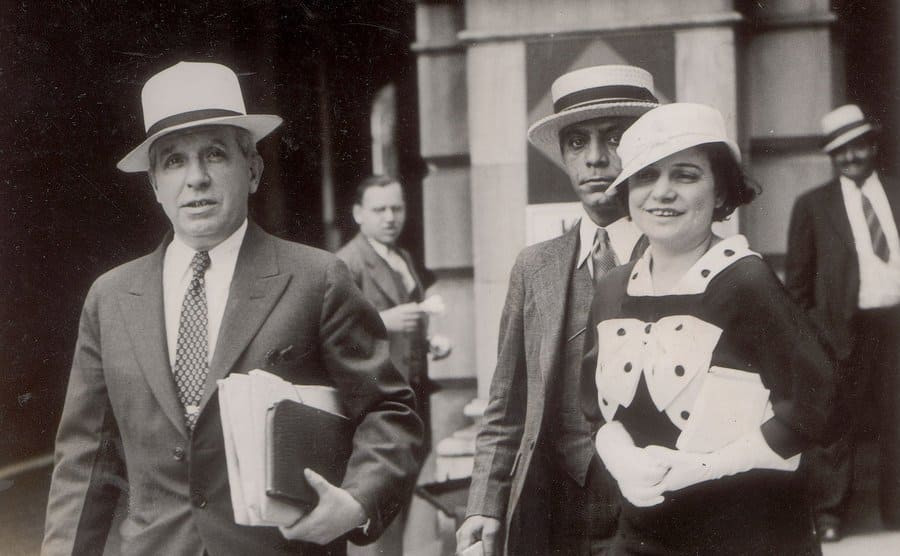 Charles Ponzi and his wife walking away from a government building
