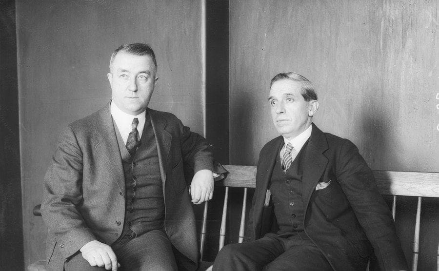 Charles Ponzi and District Attorney William Foley outside of the courtroom after his hearing