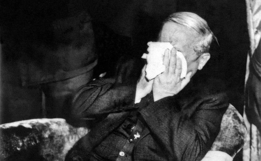 Ponzi crying into a hankercheif