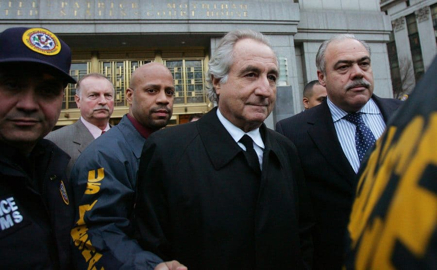Bernie Madoff being led into court by US Marshalls