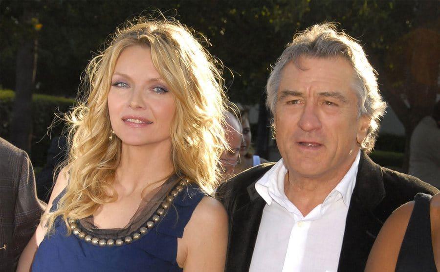 Michelle Pfeiffer and Robert De Niro walking in to a film premiere