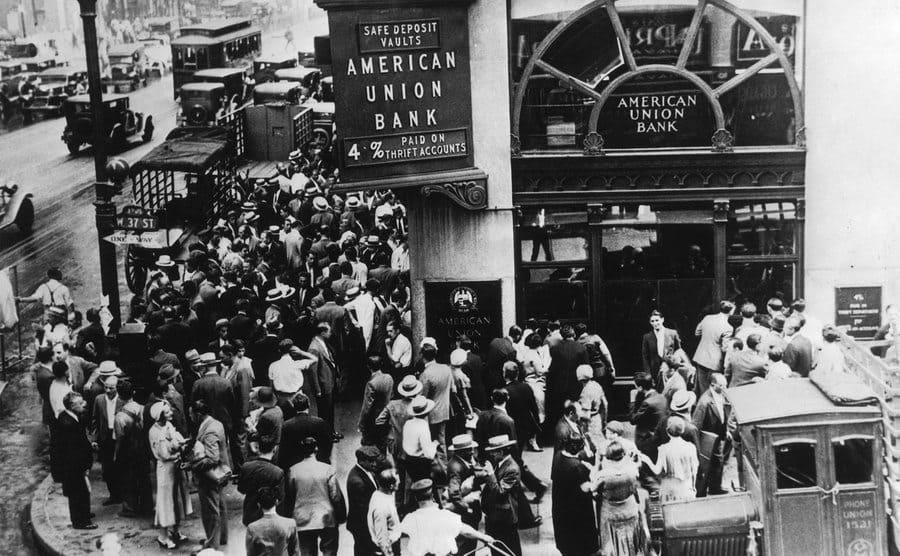 A crowd of depositors outside the American Union Bank in New York, having failed to withdraw their savings before the bank collapsed.