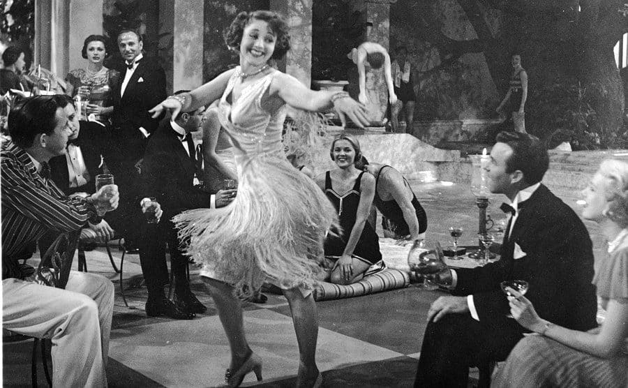 An unidentified woman wearing a 'flapper'- style skirt dances at a party in a still from the film, 'The Great Gatsby' 1949.