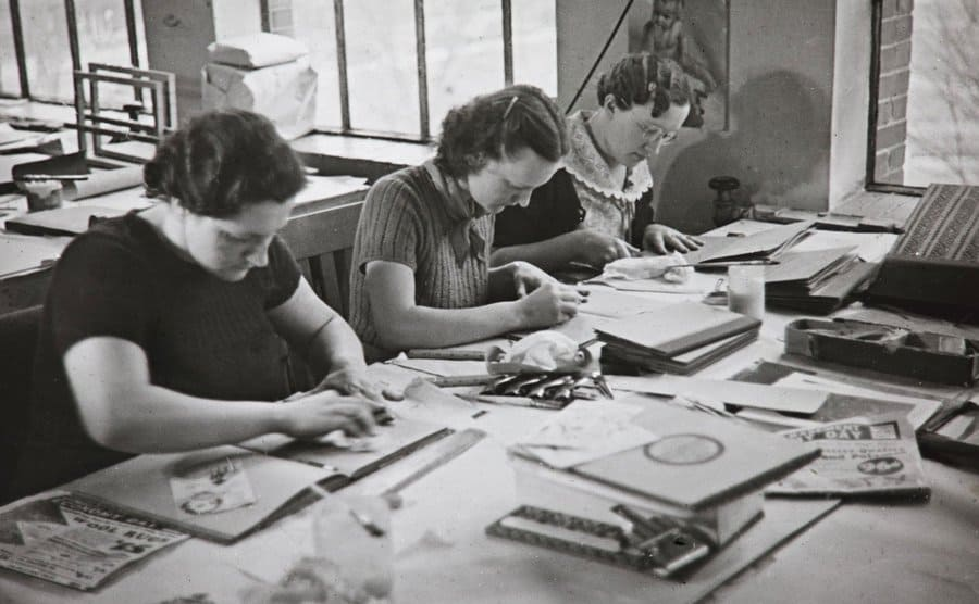 Women in the Milwaukee Handicraft Project being trained in scrapbooking.