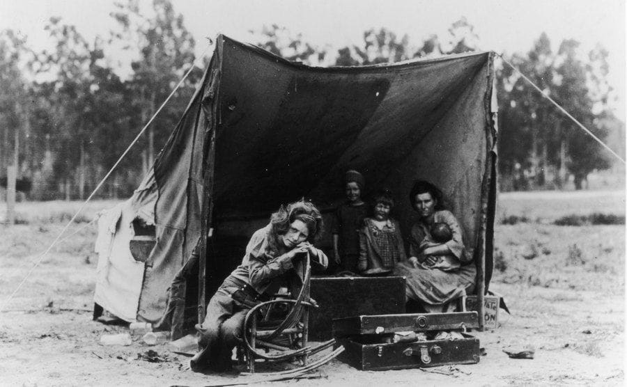 Florence Thompson and her children and another woman - photographed by Dorothea Lange - at a temporary camp in California.