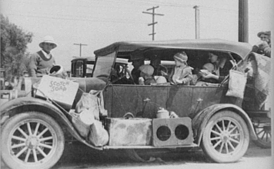 Oklahoma dust bowl refugees reach san Fernando California in an overloaded vehicle.