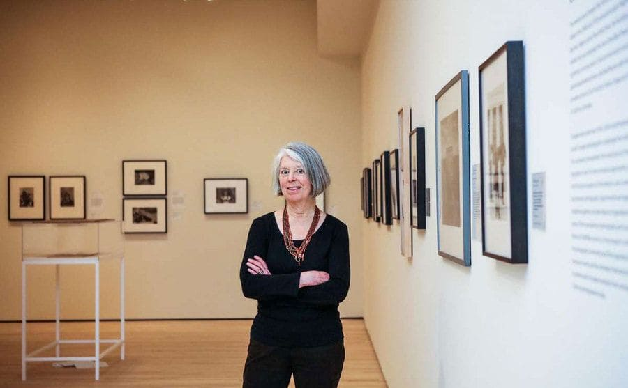 Sandra Philips standing in front of an exhibit in the SFMOMA.
