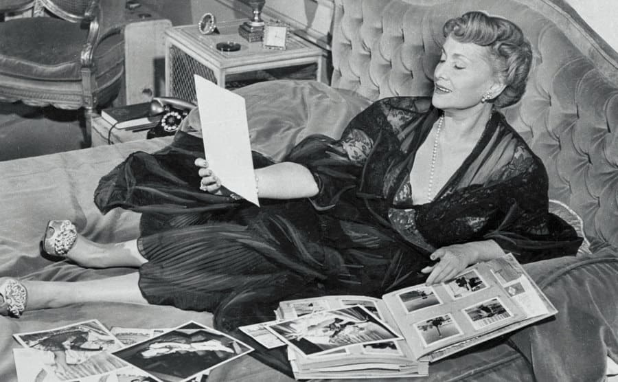 The Gabor sisters mother lying in bed updating her scrapbooks