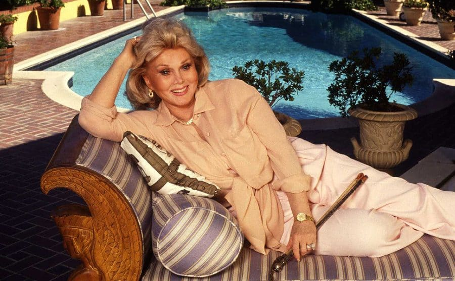 Zsa Zsa Gabor poolside at her Bel-Air mansion