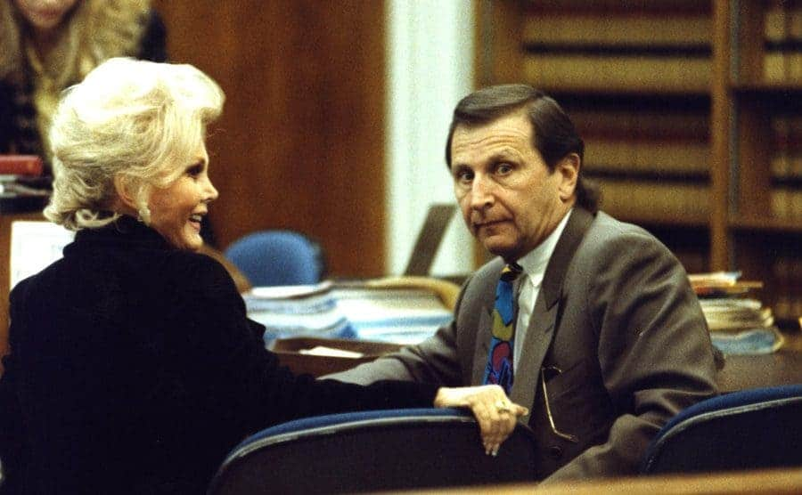 Zsa Zsa Gabor in court sitting next to her lawyer.