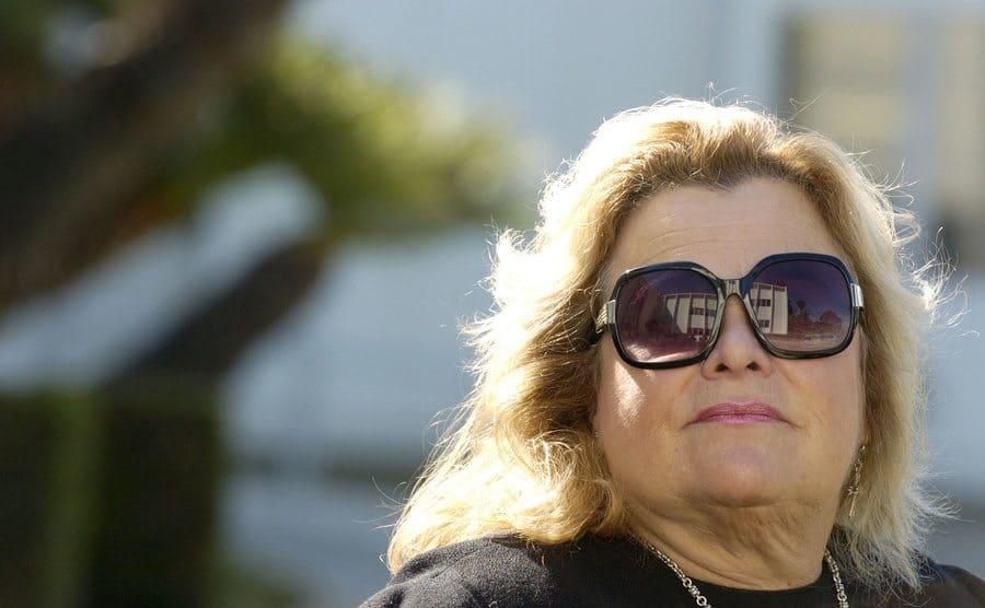 Francesca Hilton posing outside with sunglasses