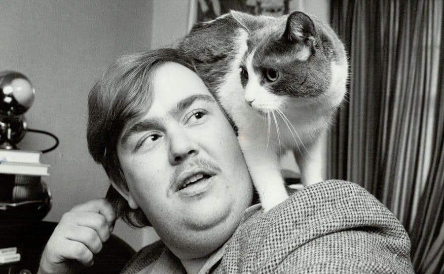 John Candy with his cat walking on his shoulders