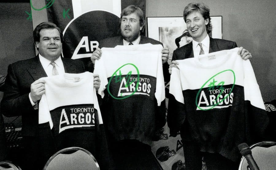 John Candy with the co-owners of the Toronto Argos