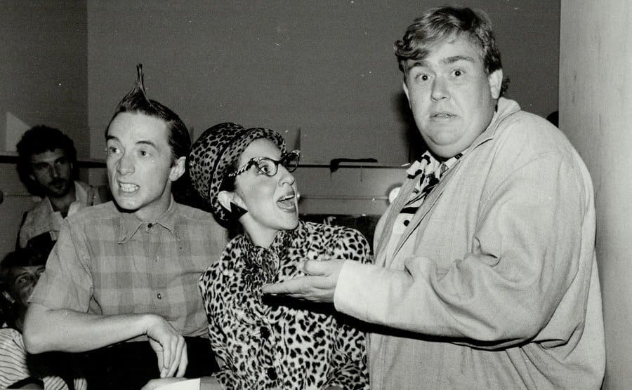 Martin Short, Andrea Martin, and John Candy hanging out backstage at an event