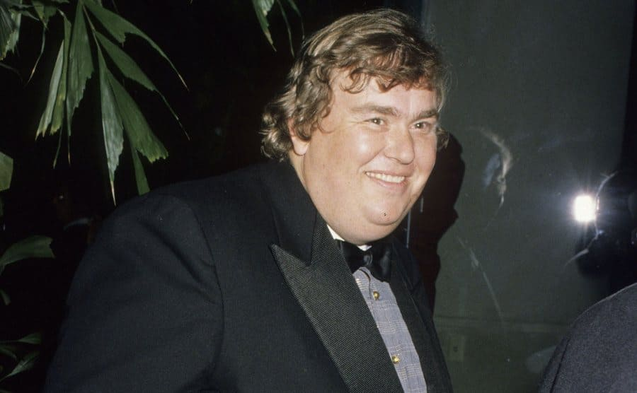 John Candy arriving to an Awards show in 1990