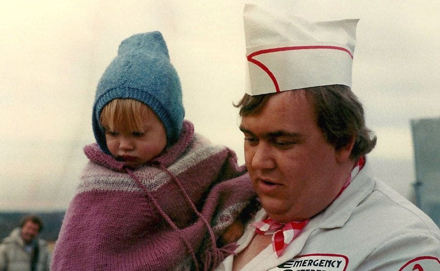 John Candy with his daughter on the set of a film