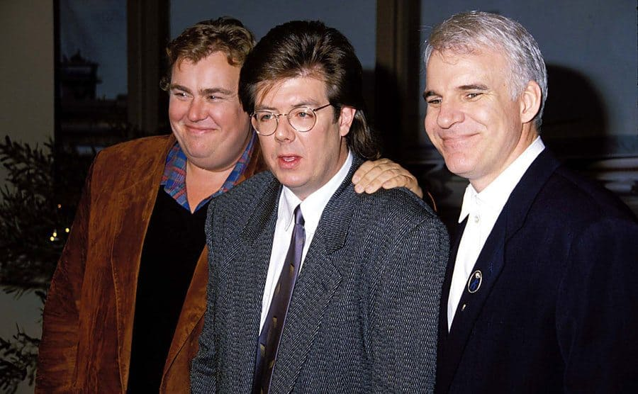 John Candy, John Hughes, and Steve Martin arriving at a press conference