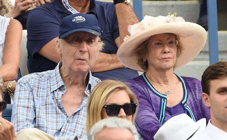 Gene Wilder and Karen Boyer watching a tennis match together
