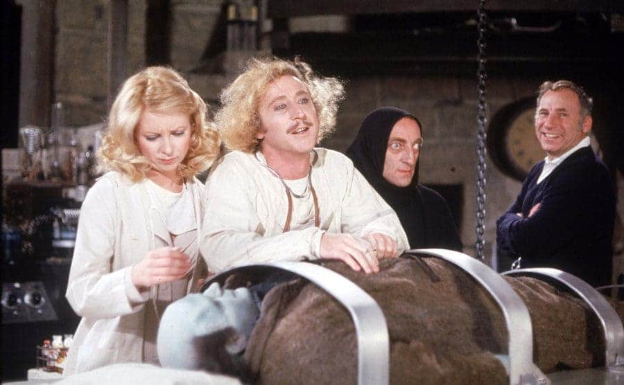 Gene Wilder with Teri Garr, Marty Feldman, Mel Brooks, and Peter Bole behind the scenes of the film Young Frankenstein