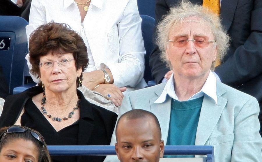 Karen Boyer and Gene Wilder watching a tennis match in 2008