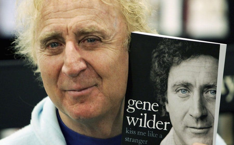 Gene Wilder holding up another one of his books